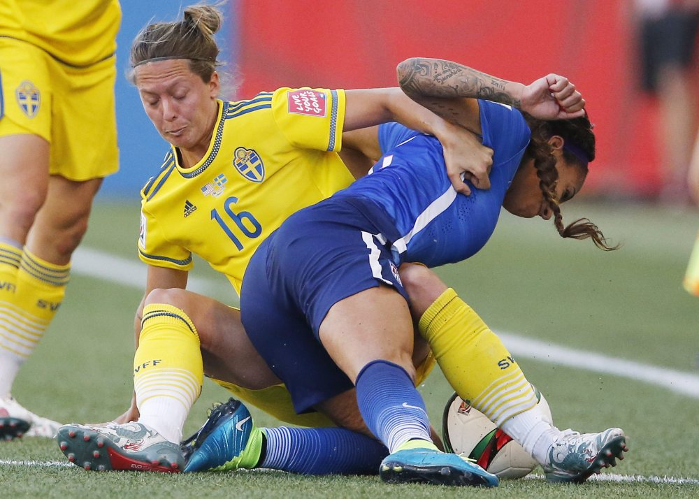 Sweden's Lina Nilsson (16) hauls down the United States' Sydney Leroux during the second of half Friday's Women's World Cup soccer match, which ended 0-0.