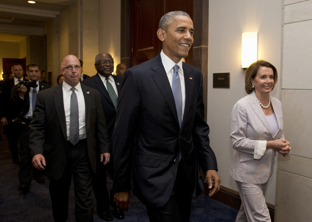 President Barack Obama walks with House Minority Leader Nancy Pelosi and House Minority Assistant Leader James Clyburn on Friday, on their way to a meeting with House Democrats on Capitol Hill. The president was making an 11th-hour appeal to drum up support for his trade agenda.