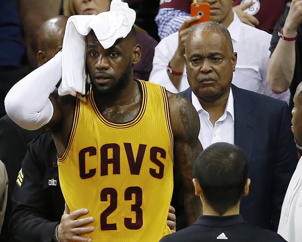 Cleveland's LeBron James needed a towel for his head Thursday night after he sustained a cut from colliding with a TV camera. James was not evaluated for a concussion.