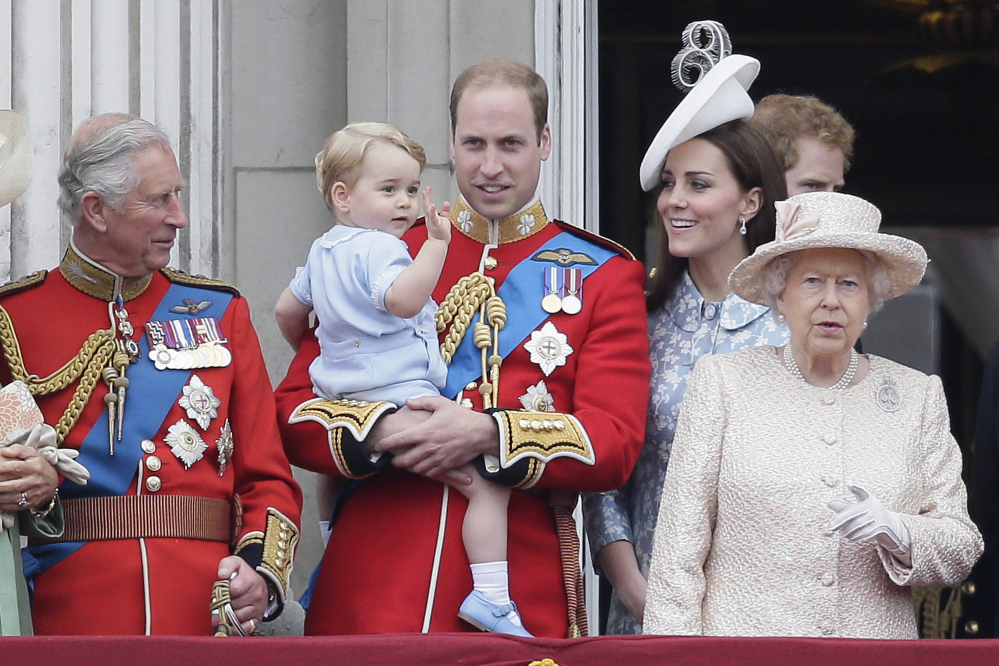 Britain's Prince William holds his son, Prince George, with Queen Elizabeth II, right, Kate, Duchess of Cambridge and the Prince of Wales during the Trooping The Colour parade at Buckingham Palace, in London on Saturday.