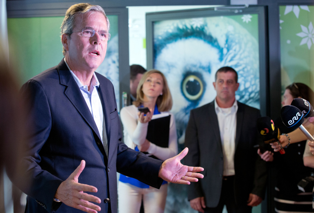 Jeb Bush speaks to journalists at the e- Estonia Showroom during his visit in Tallinn, Estonia, on Saturday. Estonia, a once-bleak Soviet state, is now a growing, free-market economy.