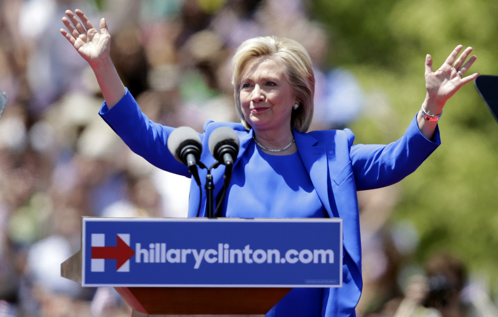 Former Secretary of State Hillary Rodham Clinton gestures before speaking to supporters Saturday on Roosevelt Island in New York. The speech was promoted as her formal presidential campaign debut.
