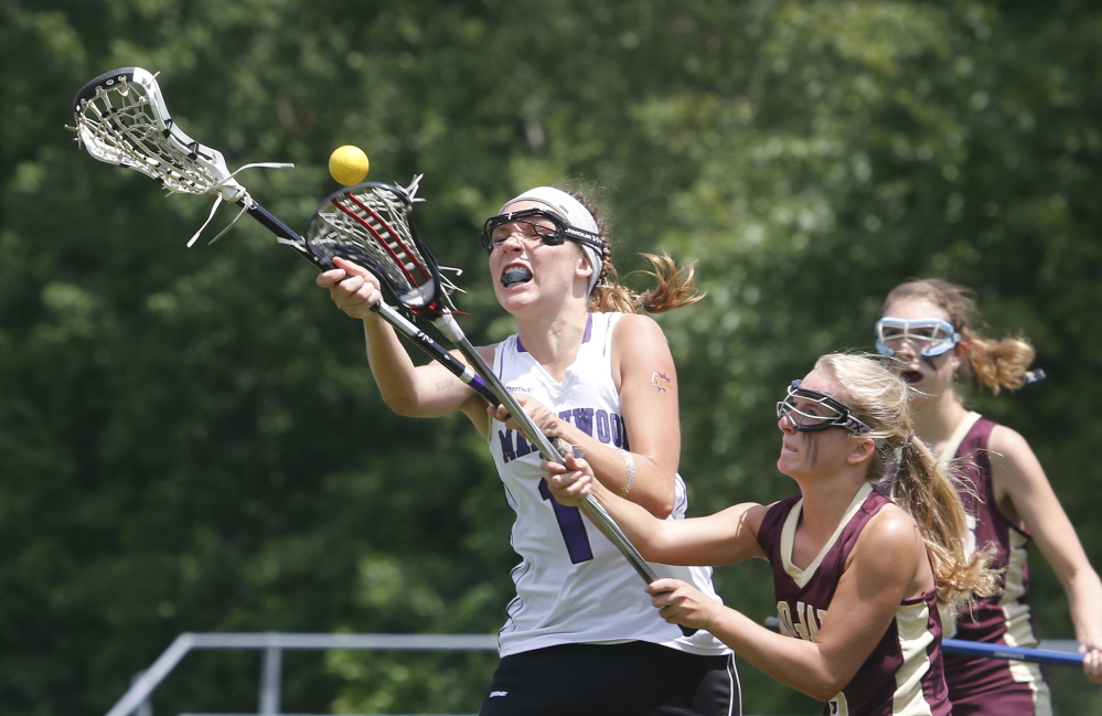Isabelle Ury of Marshwood, left, competes for a loose ball with Julianna Grondin of Thornton Academy during the second half of Marshwood's 4-2 victory in a Western Class A girls' lacrosse semifinal.