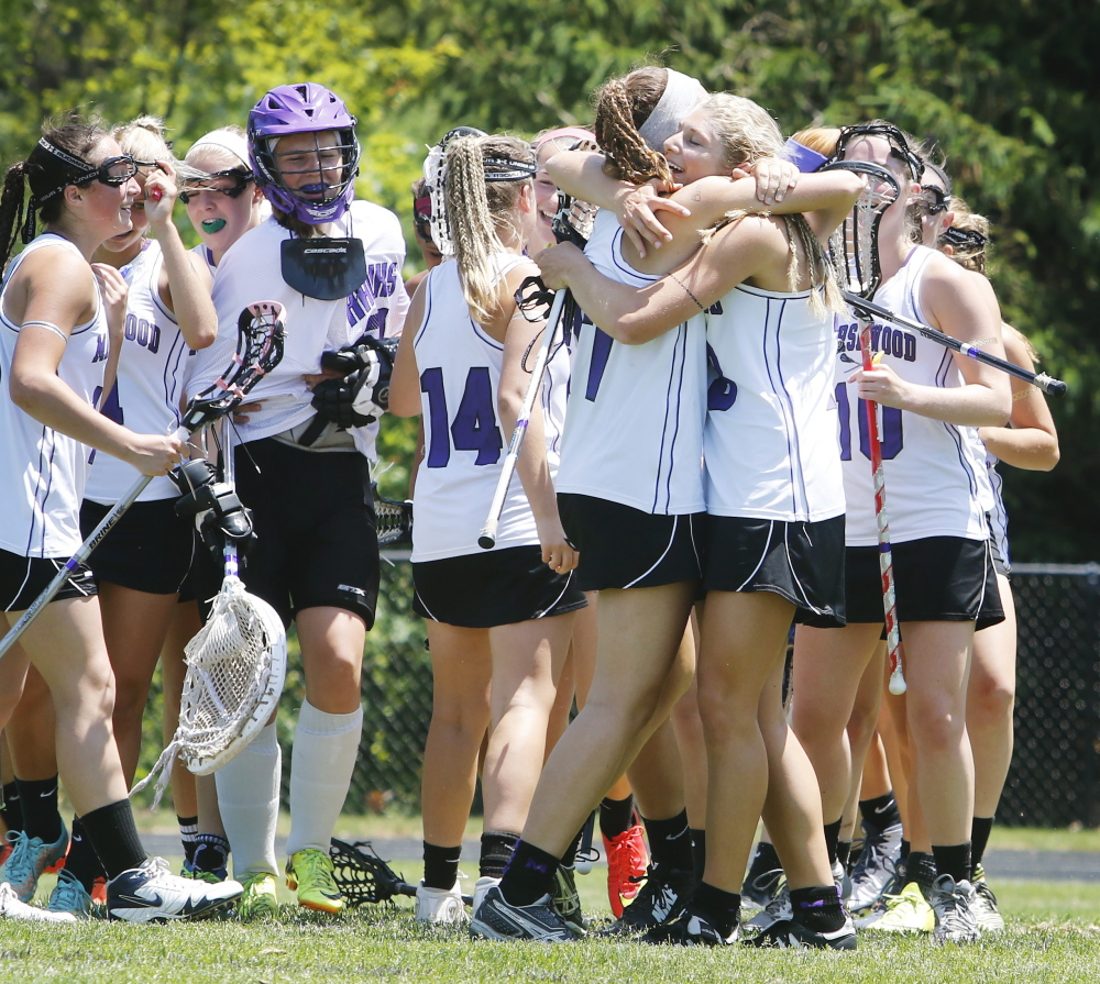 Marshwood's Lindsey Poirier and Korinne Bohunsky embrace after the Hawks defeated Thornton Academy 4-2 Saturday to advance to the Western Class A girls' lacrosse regional final.