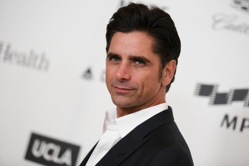 Actor John Stamos arrives at the 4th Annual Reel Stories, Real Lives Benefit in Los Angeles in April. Stamos was arrested and cited with driving under the influence in Beverly Hills. Police said they received calls around 7:45 p.m. Friday reporting a possible drunk driver. Police later stopped Stamos, who was the only person in the vehicle. Police said Stamos was taken to a hospital because of a possible medical condition.