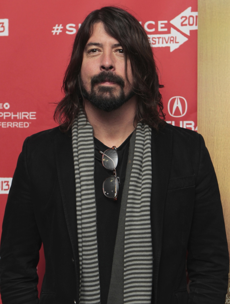 Dave Grohl, the Foo Fighters' frontman, fell off a stage in Sweden and fractured a leg, the band says.