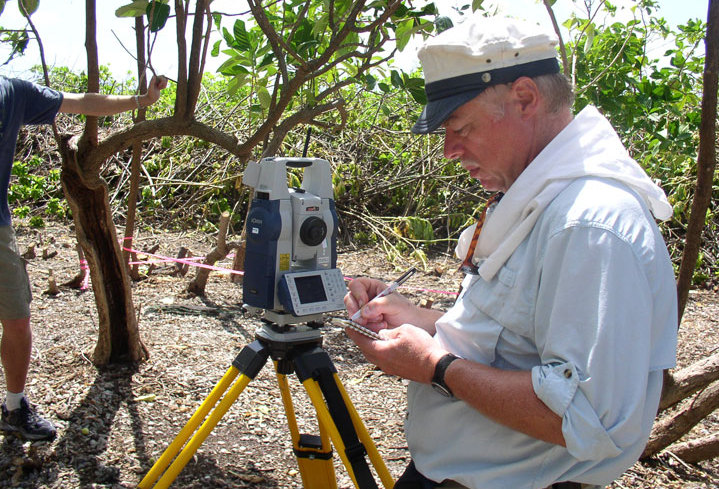 Ric Gillespie, co-founder of The International Group for Historic Aircraft Recovery, in photo at left, surveys an area during an expedition to the South Pacific island of Nikumaroro in Kiribati. Some question that his finds are tied to Amelia Earhart.