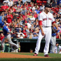 Boston Red Sox relief pitcher Matt Barnes stands on the mound after giving up the winning home run to Toronto Blue Jays' Russell Martin, left, in the 11th inning Saturday at Fenway Park.