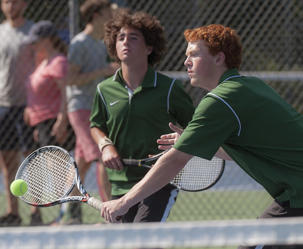 Peter Michalakes, left, and Stephen Epstein of Waynflete compete during Waynflete's 4-1 victory against George Stevens Academy in the Class C boys' tennis finals Saturday at Lewiston.