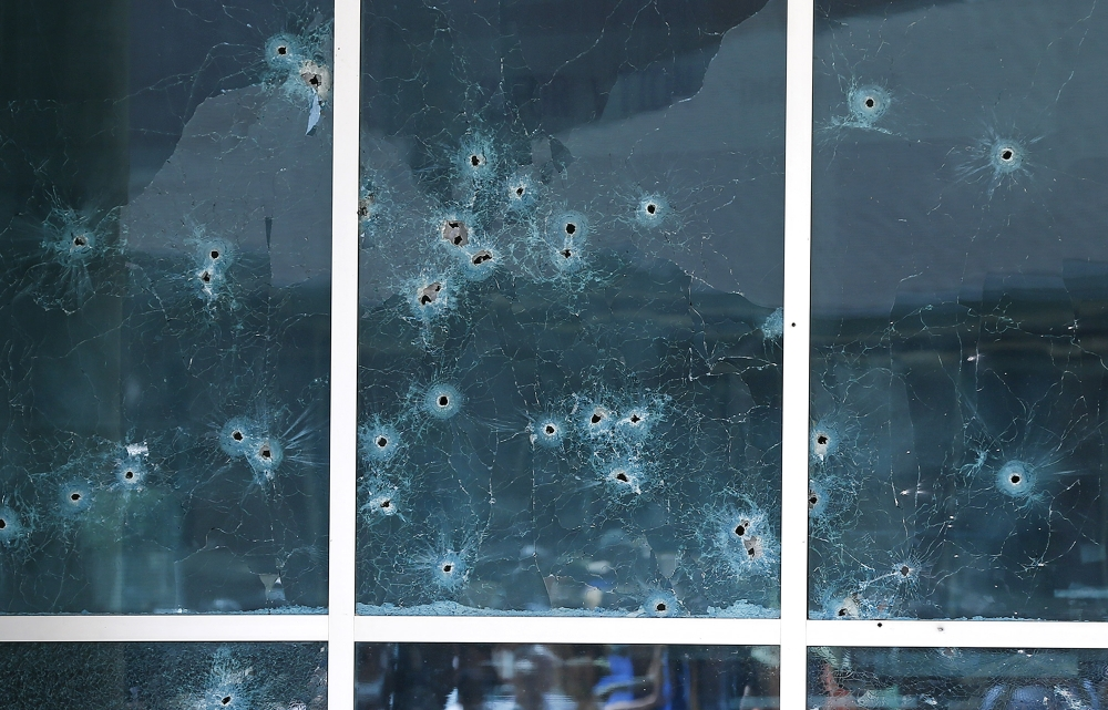 Bullet holes in windows at Dallas Police headquarters.