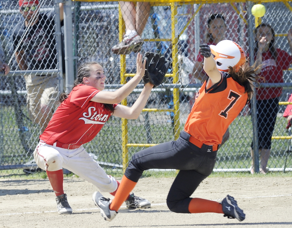 Biddeford's Erin Martin slides safely into third as Scarborough's Maggie Murphy waits for the throw during the Red Storm's 6-5 win Saturday in Scarborough.
