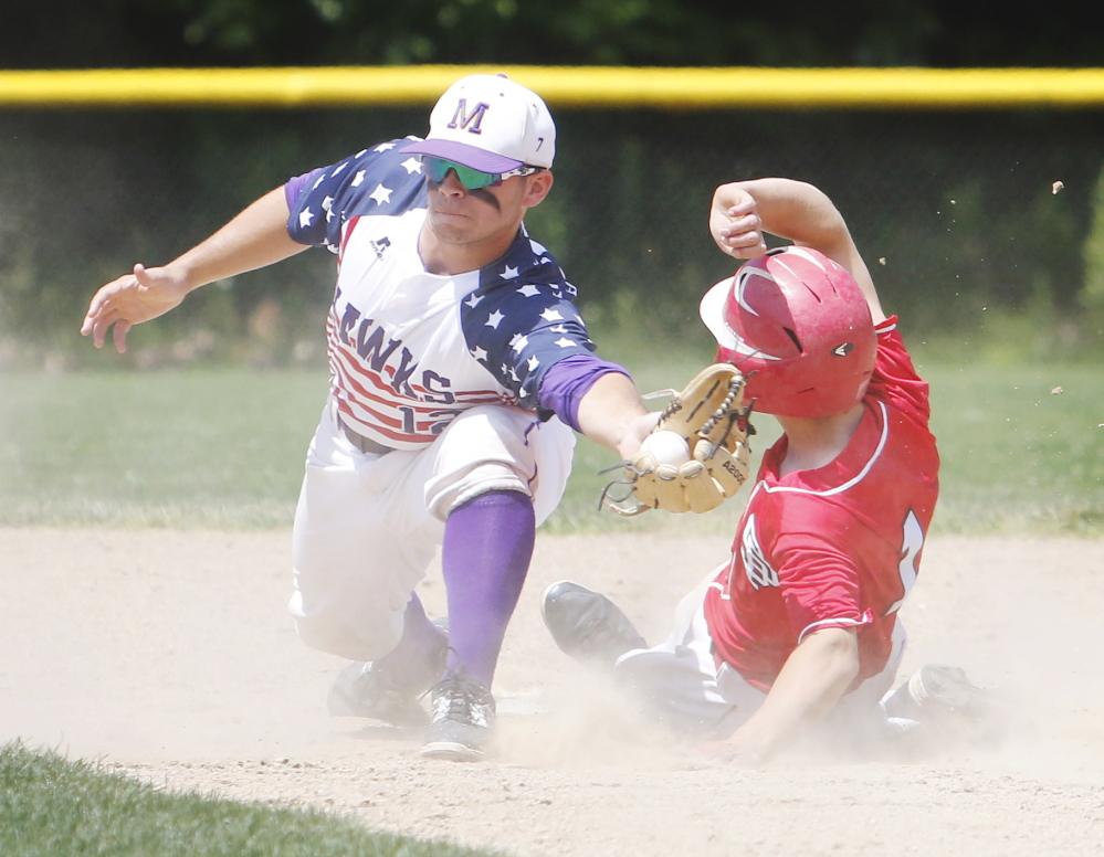 Noah McDaniel of Marshwood tags out Jacob Brown of South Portland at second base in the fourth inning of South Portland's 9-8 win Saturday in a Western Class A semifinal at South Berwick.