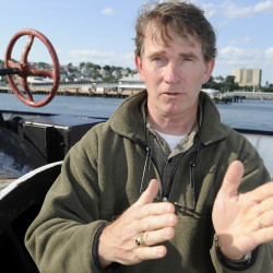 Michael C. Hurley of Charleston, S.C., describes how his 30-foot sailboat was heeling over during a storm and taking on water before he was rescued by the crew of a Maine Maritime Academy training ship.