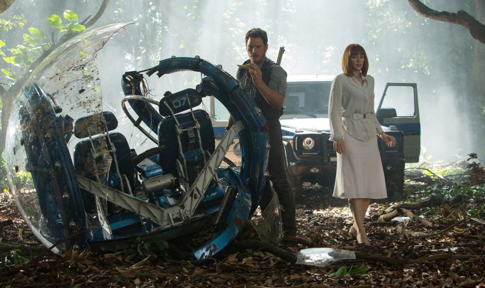 """Chris Pratt, left, and Bryce Dallas Howard star in a scene from """"Jurassic World,"""" directed by Colin Trevorrow."""