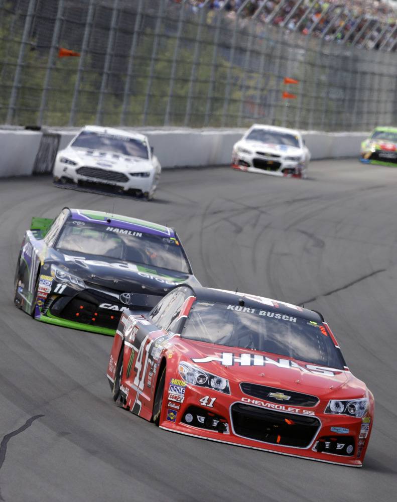 Kurt Busch was in the lead at the right time Sunday at Michigan International Speedway, as the race was stopped after 138 laps because of heavy rain.
