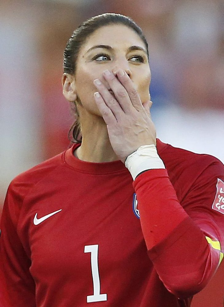 Hope Solo sends a kiss to fans after the U.S. played to a scoreless draw Friday against Sweden.