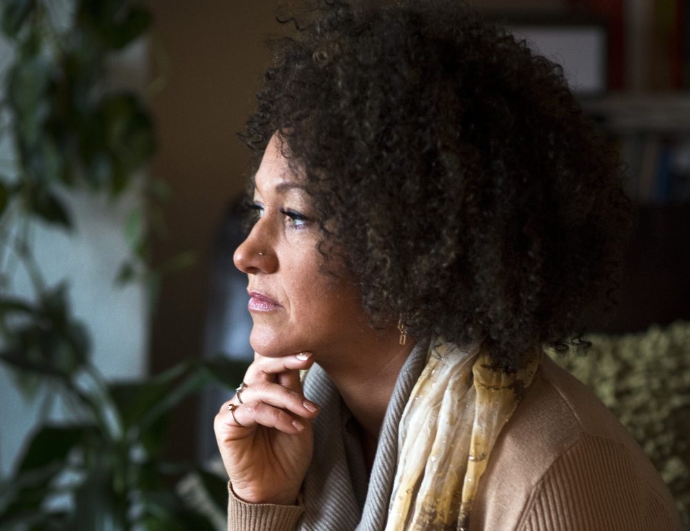 Rachel Dolezal is stepping down as president of the Spokane chapter of the NAACP after her family said she is white and that she has falsely portrayed herself as black.