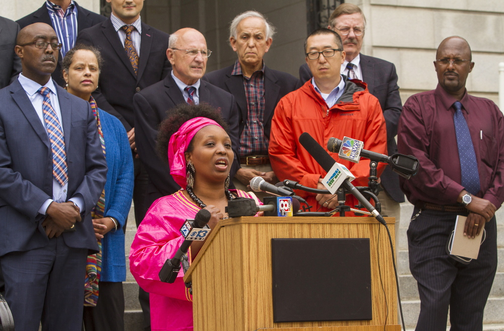 Aimee Nyirakanyana, owner of the Ebenezer African Grocery Store, speaks during a news conference Monday to advocate for lawmakers to support the General Assistance legislation that would assist asylum seekers.