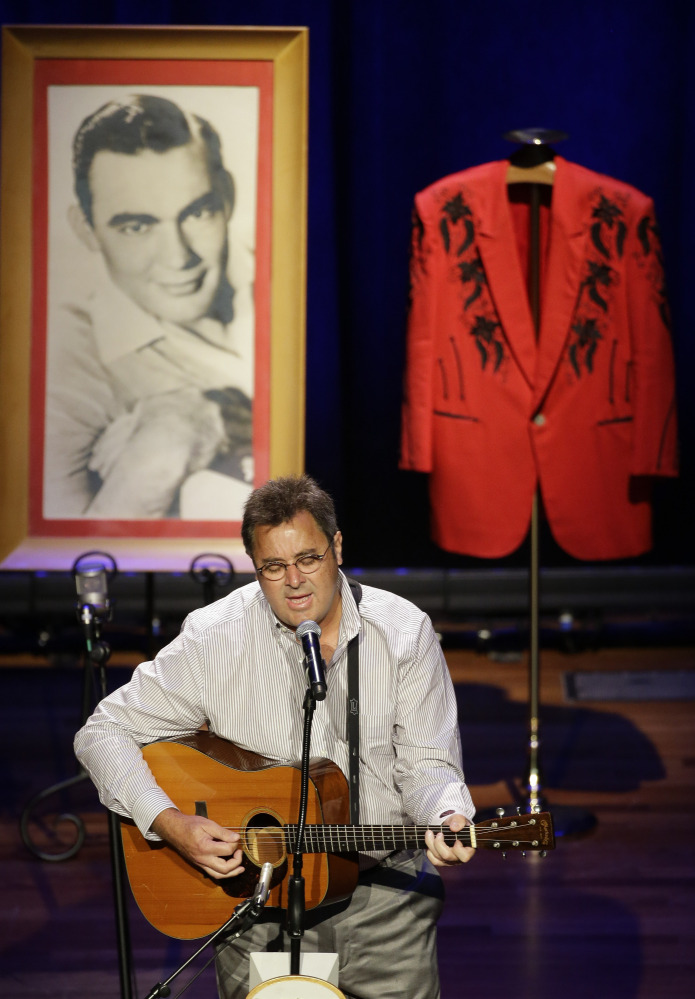 Vince Gill performs during the funeral service for country music performer Jim Ed Brown.