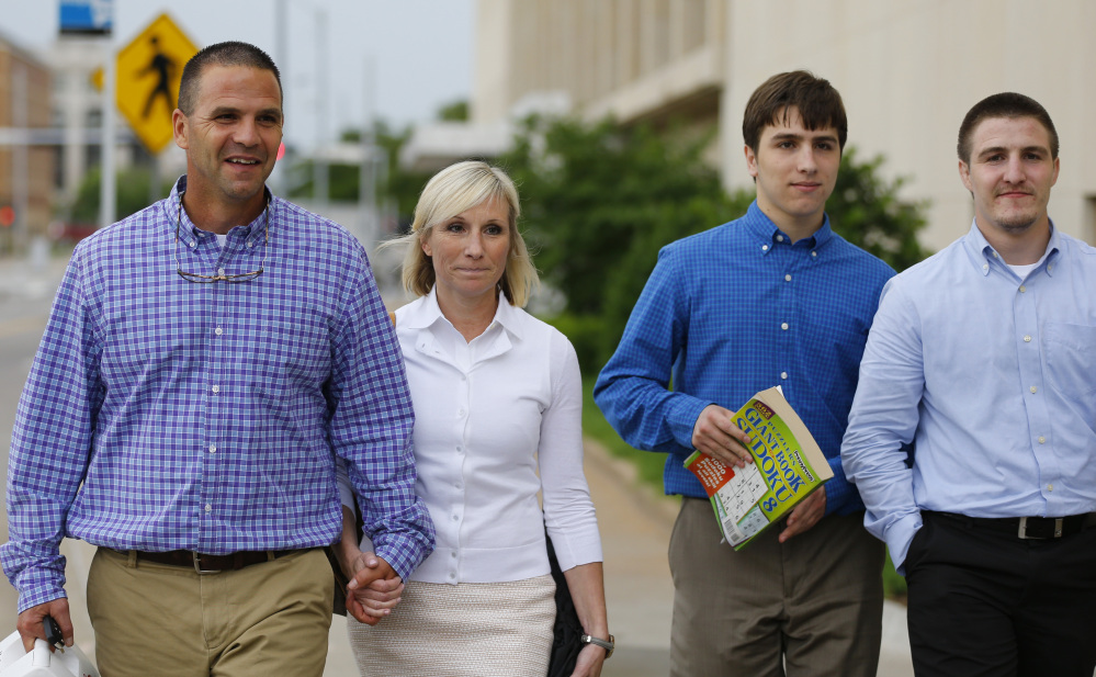 The suspect's family, from left, parents Kyle and Melissa Durham, and brothers Josh and Zac Durham, leave federal court Monday in Oklahoma City.