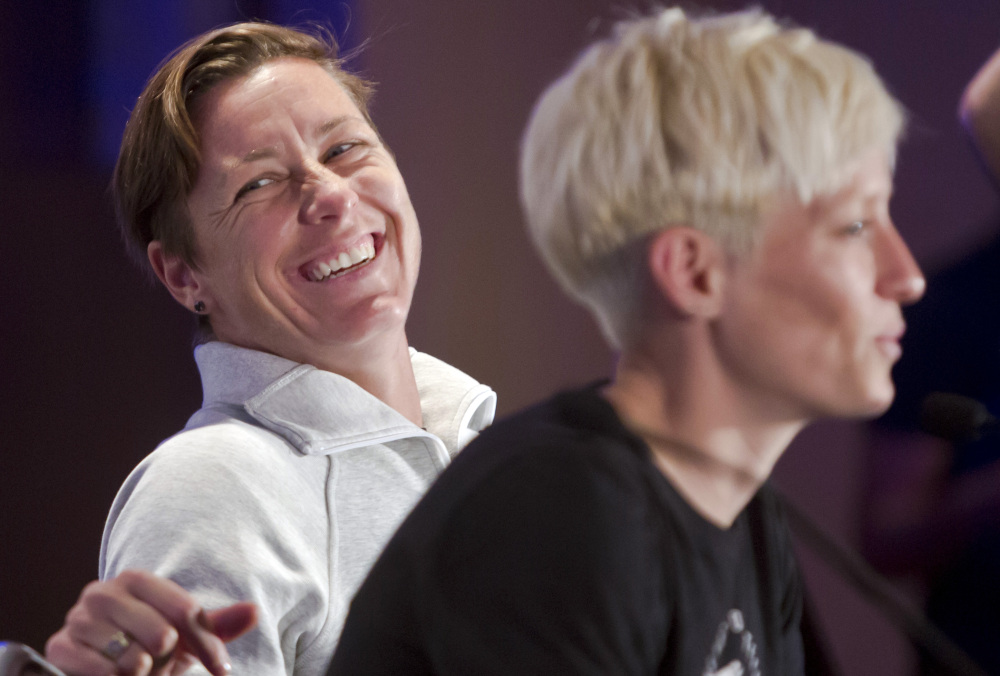 Abby Wambach, left, laughs as Megan Rapinoe speaks during the U.S. women's soccer team World Cup media day in New York last month.  AP file photo
