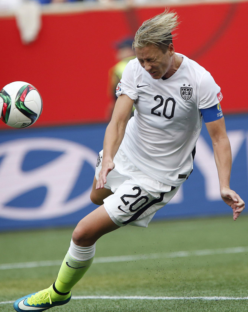 Abby Wambach, who is being used as both a starter and a sub, believes she'd have more goals if the Cup were played on grass.