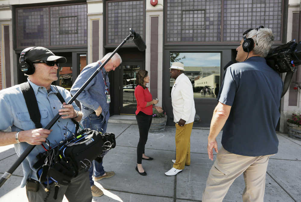 Former Spokane, Wash., NAACP chapter president James Wilburn Jr., center, speaks with the media outside the organization's office Monday following the resignation of Rachel Dolezal over accusations she faked her racial identity.