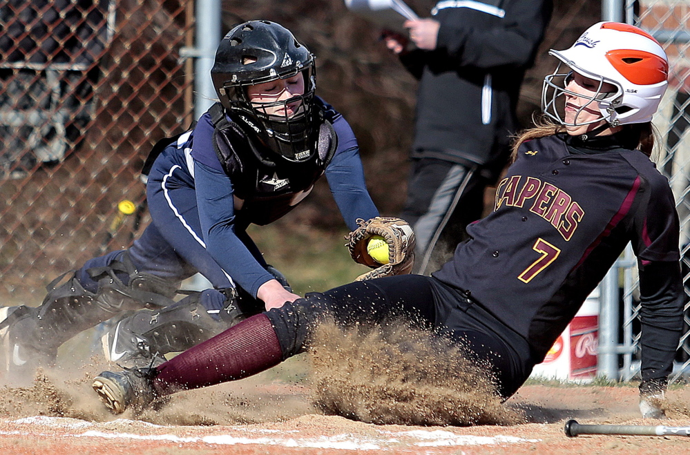 Catcher Kallie Hutchinson, left, is one of two seniors on a Yarmouth team that bounced back from a tough loss in the regional semis last year to earn a berth in the final this year.