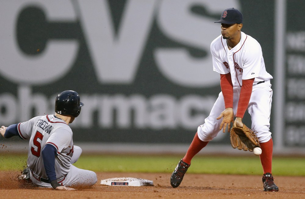 The Atlanta Braves' Freddie Freeman steals second base on a bad throw from Red Sox catcher Sandy Leon to Xander Bogaerts in the fourth inning Monday night in Boston.