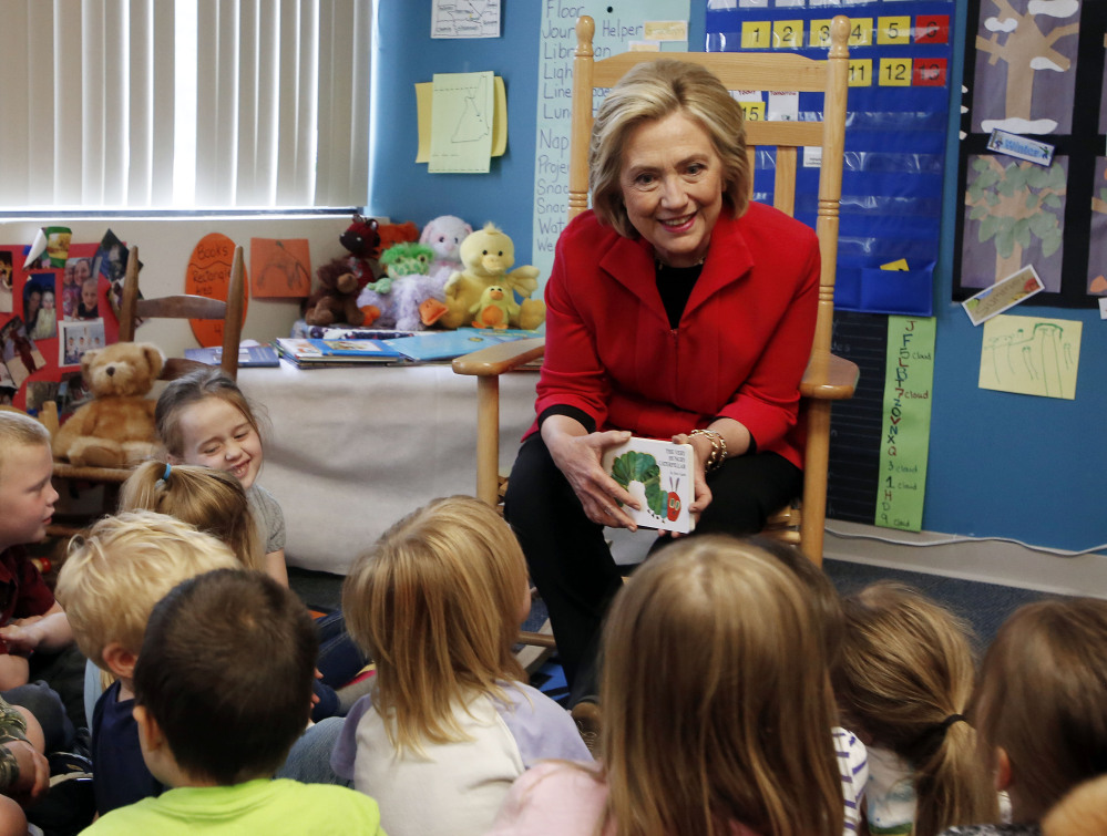 "Democratic presidential candidate Hillary Rodham Clinton meets with a group of preschoolers during a campaign stop Monday in Rochester, N.H. She said, ""You shouldn't think of childcare as just a place to deposit your kids."""