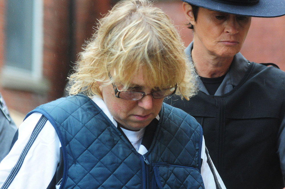 Joyce Mitchell heads into Plattsburgh City Court for a hearing on Monday in Plattsburgh, N.Y. Mitchell is charged with helping convicted murderers Richard Matt and David Sweat escape from Clinton Correctional Facility.