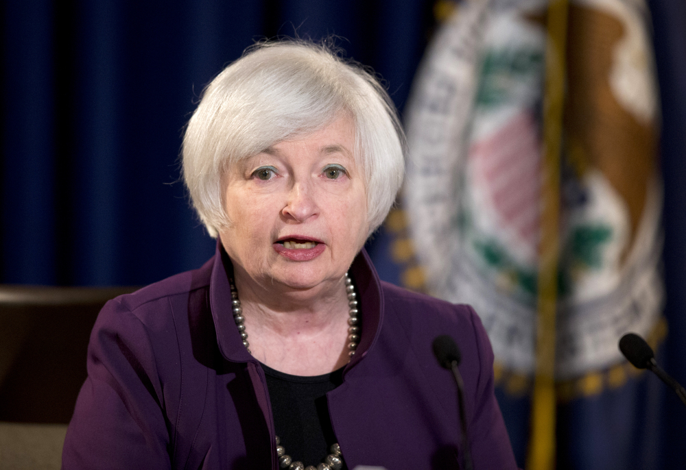 Federal Reserve Chair Janet Yellen speaks during a news conference in Washington on Wednesday. The Federal Reserve significantly lowered its estimate of economic growth this year.