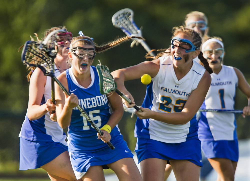 Kennebunk's Hailey Fecko and Falmouth's Elizabeth Goodrich battle for a loose ball during Wednesday's Western Class B girls' lacrosse final at Falmouth. Kennebunk won, 9-7.
