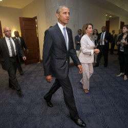 President Barack Obama and House Minority Leader Nancy Pelosi of California leave a meeting Friday with House Democrats on Capitol Hill in Washington to discuss the global trade talks.