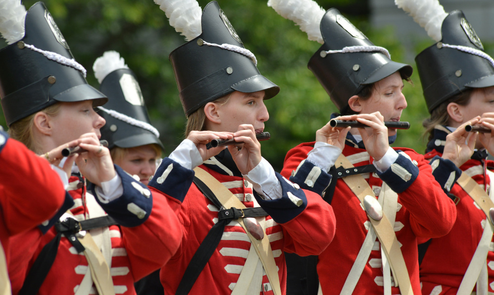 Members of a fife and drum corps play Wednesday in Boston. A time capsule, containing artifacts including coins and a silver plaque, was originally placed at the Statehouse by Gov. Samuel Adams and Paul Revere in 1795.