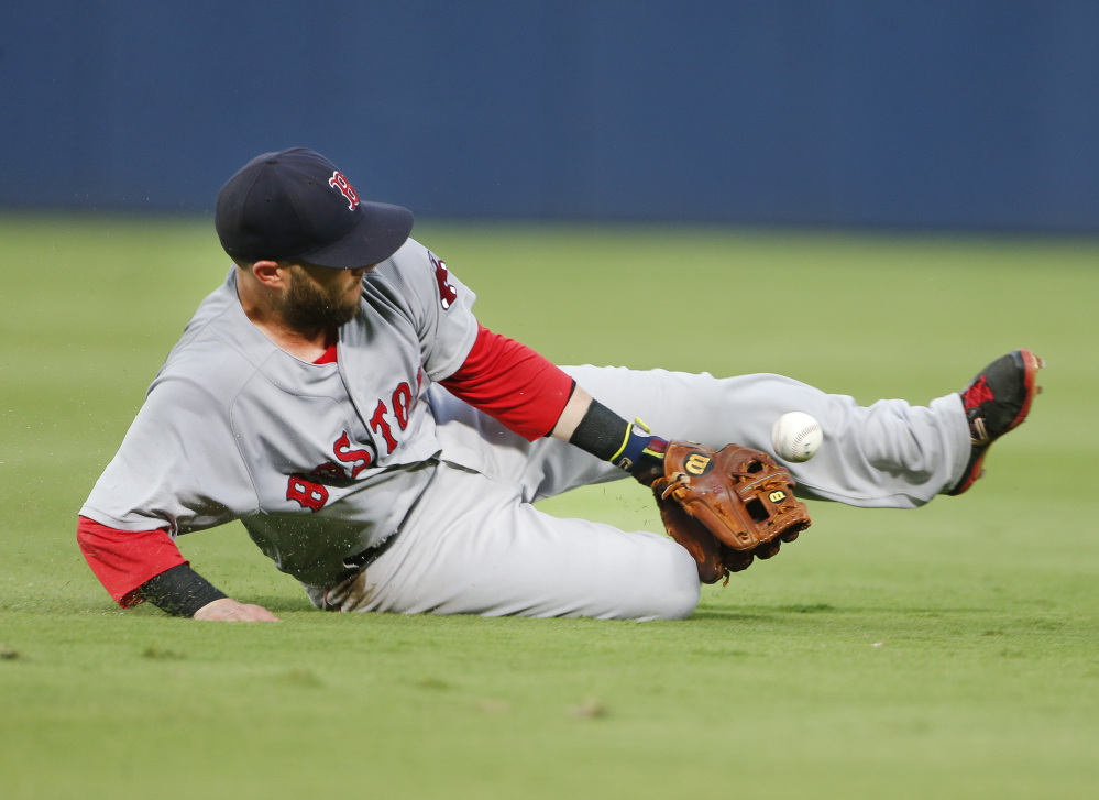 A ground ball by the Braves' Pedro Ciriaco gets past Dustin Pedroia in the fourth inning Wednesday night in Atlanta. Pedroia was charged with an error, Ciriaco advanced to second base and a run scored on the play.