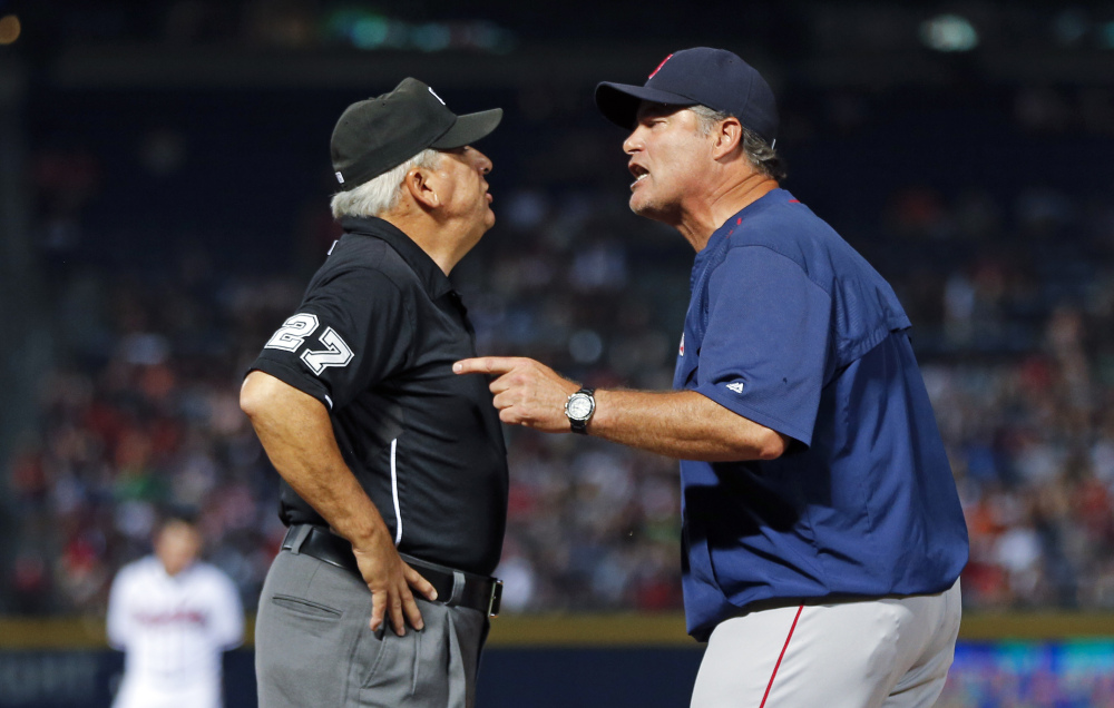 Boston Red Sox manager John Farrell argues with umpire Larry Vanover about balls and strikes in the seventh inning Wednesday night. Farrell got ejected from the game.