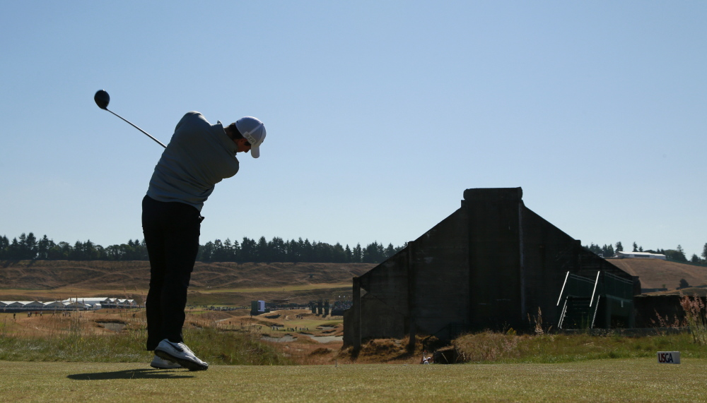 Rory McIlroy hits a tee shot on the 18th hole during a practice round for the U.S. Open at Chambers Bay on Wednesday in University Place, Wash. The U.S. Open begins Thursday on a course many consider to be link-like.