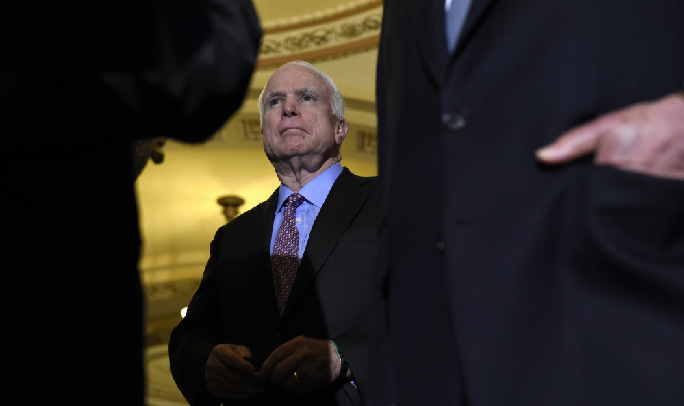 Senate Armed Services Committee Chairman John McCain, R-Ariz., listens during a news conference on Capitol Hill in Washington on Tuesday. The Senate passed a $612 billion defense policy bill Thursday.