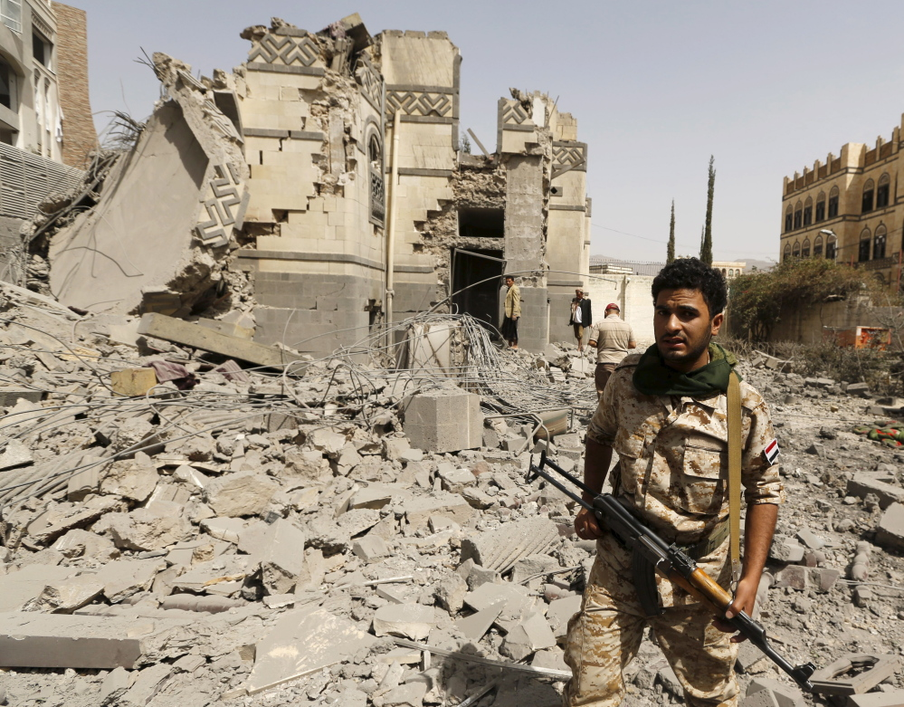 A Houthi militant stands in Sanaa, Yemen, on Sunday. Months of fighting helped create conditions leading to disease.