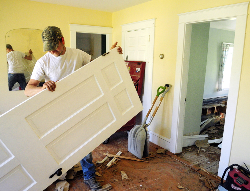 Wesley Jandreau carries out a door on Wednesday at the former Elizabeth Arden estate in Rome, which is being renovated for the Travis Mills Foundation.