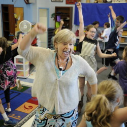 """Karen Renton and her students move and sing their way through an action-packed song called """"Sasha"""" at Yarmouth Elementary School. Wednesday was the last day of a long teaching career for Renton, who is retiring – but she didn't expect it to hit her until school starts in the fall without her."""