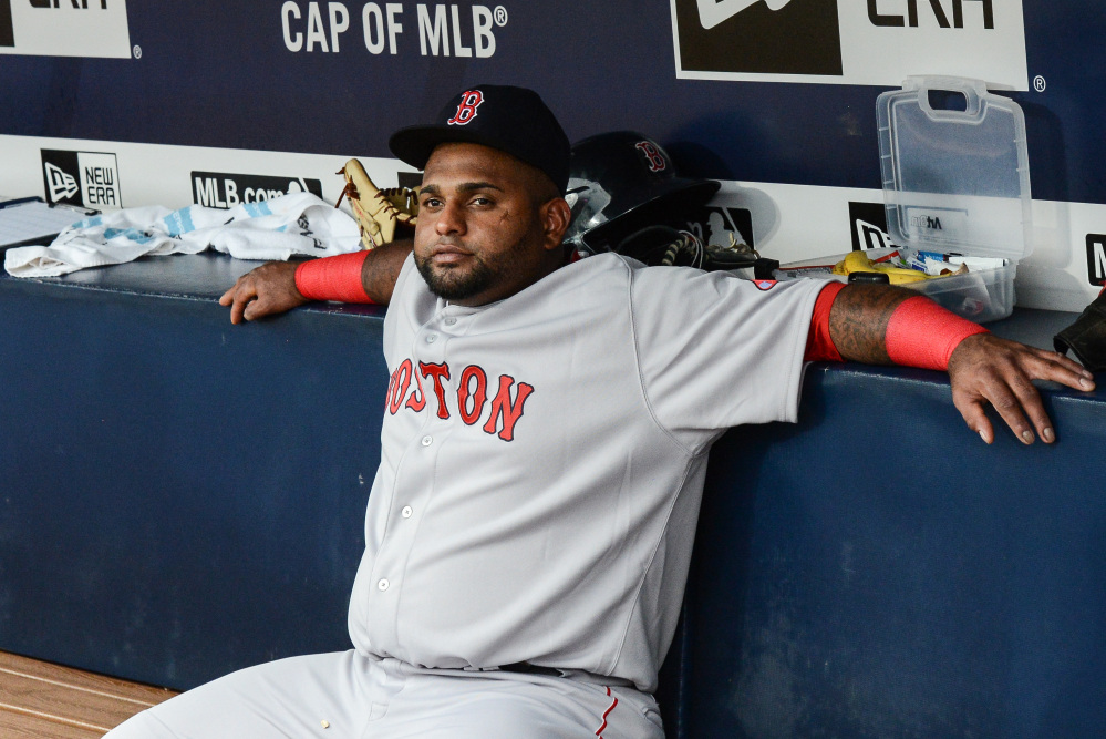 Boston Red Sox third baseman Pablo Sandoval sits on the bench before the start of Thursday night's game against the Atlanta Braves. Manager John Farrell benched Sandoval because the players used his Instagram account during a loss to the Braves on Wednesday.