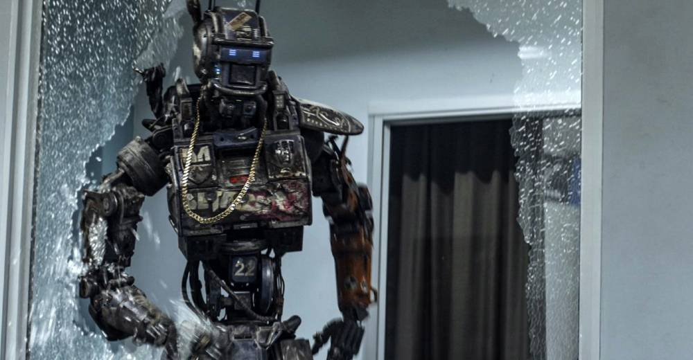 "A police robot has the ability to process human thought and emotion in ""Chappie"""