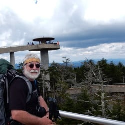 Carey Kish stands atop 6,625-foot Clingman's Dome, the highest point on the Appalachian Trail.