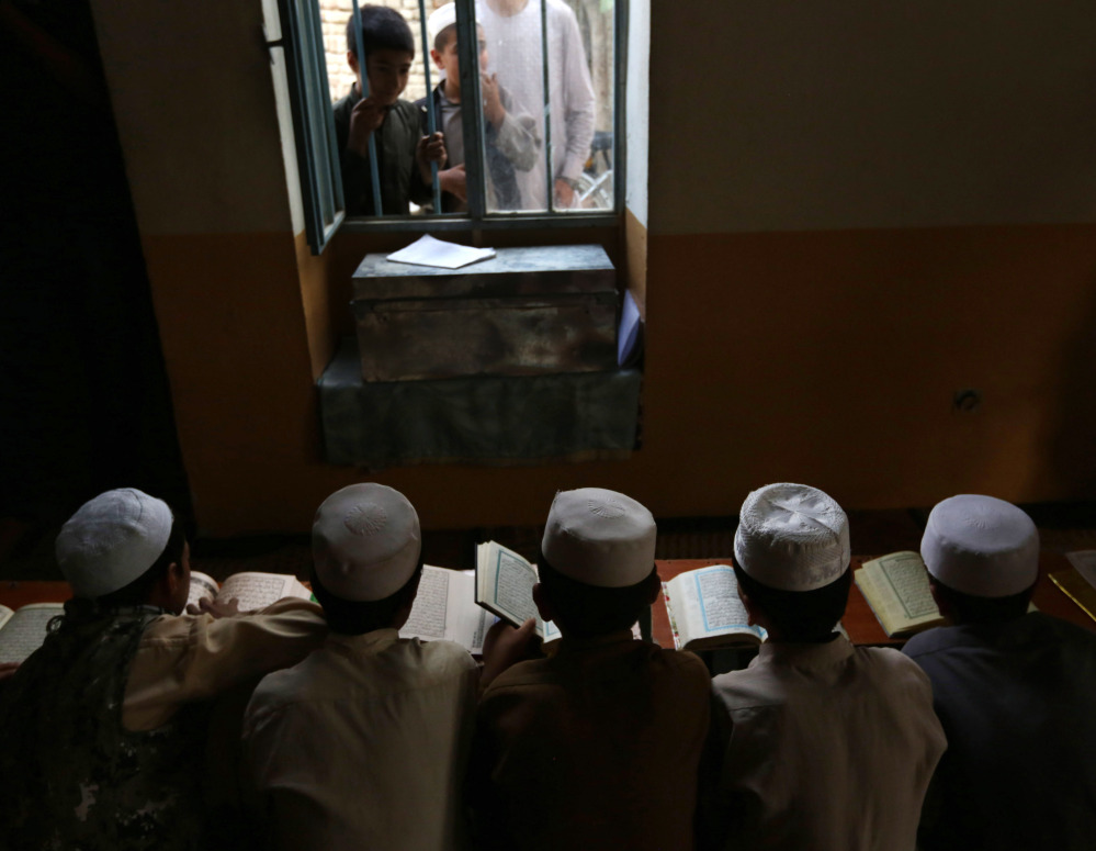 Afghan boys read the Quran during the Muslim holy month of Ramadan at a mosque in Kabul.