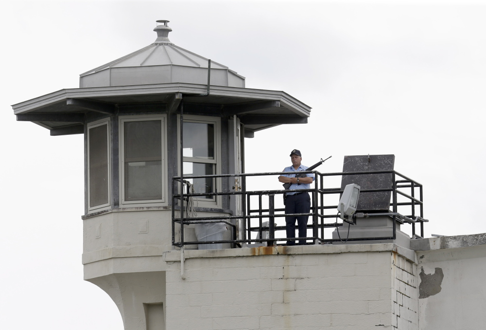 A prison employee stands guard on a tower at the Clinton Correctional Facility in Dannemora, N.Y., on June 10. Two men who escaped from the maximum-security prison June 6 are the subjects of a massive manhunt.