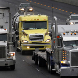 Tougher fuel-economy standards for heavy trucks and buses could reduce spending on gasoline and diesel by an estimated $170 billion, the Obama administration says.