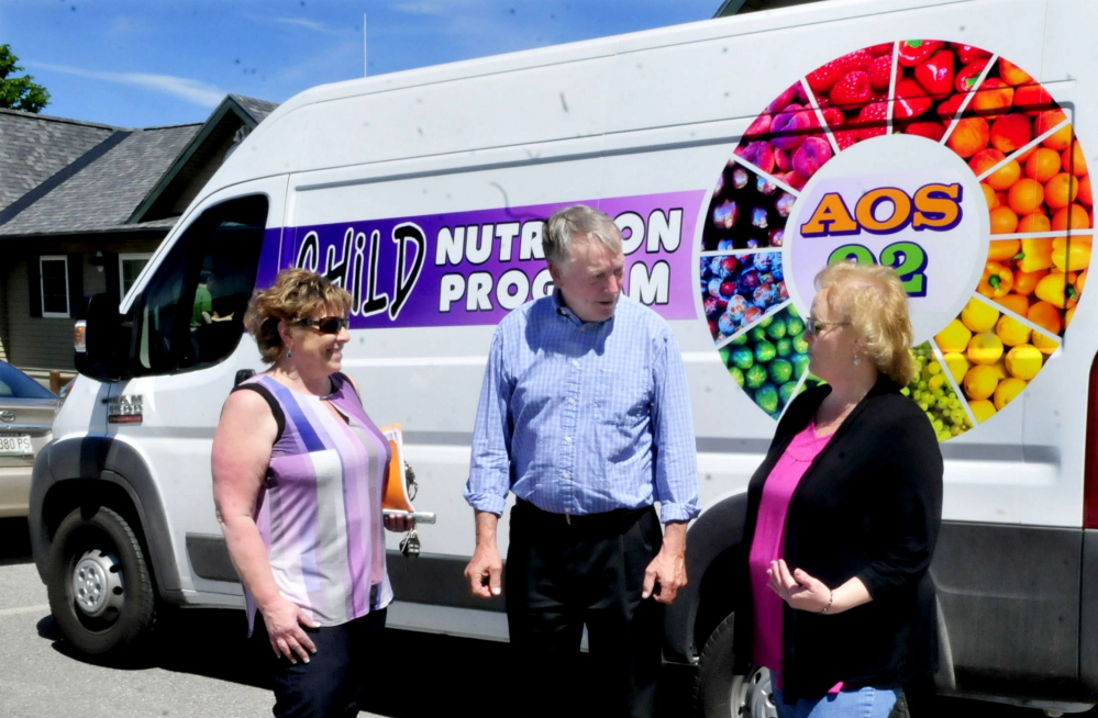 Waterville school officials on Wednesday talk outside a new van that will be used in a food program this summer. From left are Alternative Organizational Structure 92 Finance and Food Director Paula Pooler, Superintendent Eric Haley and Food Services Supervisor Barbara Bonnell.