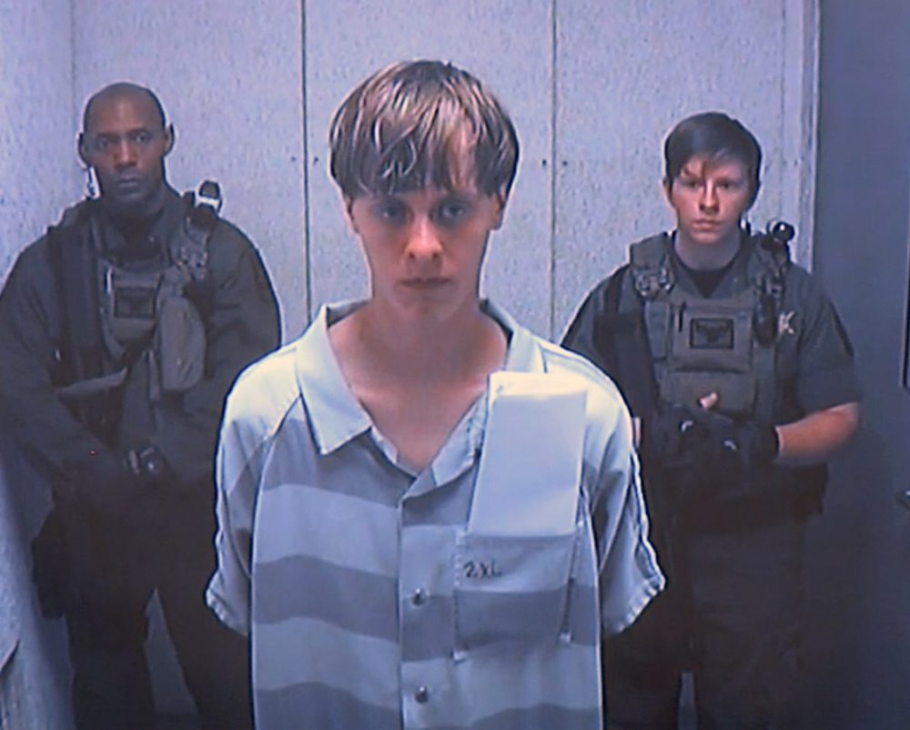 Dylann Roof, 21, appears via video before a judge in Charleston, S.C., on Friday. He is accused of killing nine people inside a black church in Charleston.